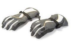 Paires de gants chauds d'hiver sur le blanc photos libres de droits