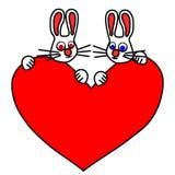 Paires de lapins blancs satisfaits Photo libre de droits