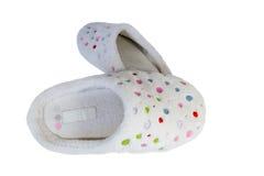 Paires de pantoufles tachetées Photo stock