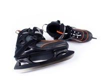 Paires de patins de hockey sur glace de l'homme Photo stock