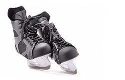 Paires de patins de hockey sur glace d'isolement sur le blanc Photo stock