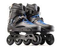 Paires de patins intégrés noirs sur le blanc Image libre de droits
