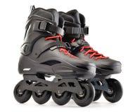Paires de patins intégrés sur le fond blanc images libres de droits