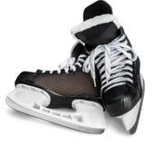 Paires de patins noirs de hockey sur glace, d'isolement dessus Photographie stock libre de droits