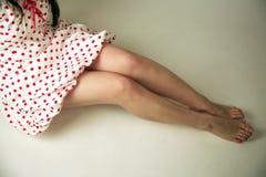 Paires de pattes avec la jupe Photographie stock