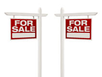 Paires de pour signes de Real Estate de vente avec le chemin de coupure Photographie stock libre de droits
