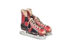 Paires de rétros patins de glace sur le fond blanc Photos stock