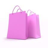 Paires de sacs à provisions roses Photographie stock libre de droits