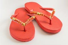 Paires de sandales rouges Photo libre de droits
