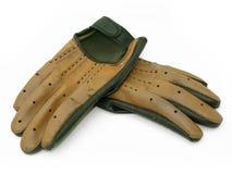 Paires de vieux gants pilotants images stock