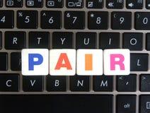 Paires de Word sur le fond de clavier photographie stock