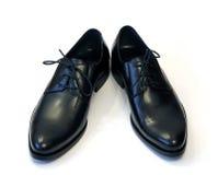 Paires des chaussures noires de l'homme Images libres de droits