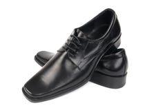 Paires des chaussures noires de l'homme Photos libres de droits
