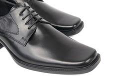 Paires des chaussures noires de l'homme Photo libre de droits