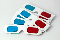 Pairs of 3D glasses. Several pairs of 3D anaglyph red-cyan paper glasses royalty free stock images