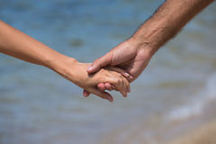 Pairs of arms on the sea view Stock Photos