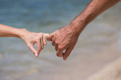 Pairs of arms on the sea view Stock Images