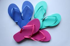 Pairs of beach shoes tong in colors Royalty Free Stock Images
