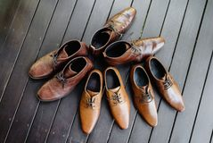 4 pairs of men's brown shoes royalty free stock images