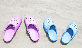 Pairs of couple sandals on the beach Stock Photo