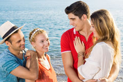 Pairs of Couple Talking at the Beach. Close up Pairs of Couples Talking at the Beach on Tropical Climate Royalty Free Stock Images