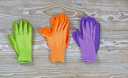 Pairs of Garden Gloves on Rustic Wood Royalty Free Stock Images