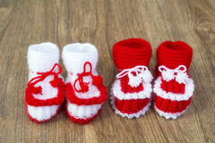 Pairs of handmade white and red knitted slippers Stock Photo