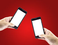 Pairs hands holding smartphone device. Royalty Free Stock Photography
