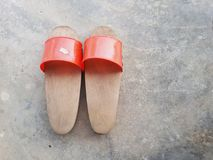 Pairs of home-made traditional wooden shoes. stock images