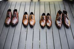 Classic brown shoes on the black wooden floor royalty free stock photography