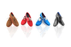 4 pairs of Mixed Colors man shoes Royalty Free Stock Photos