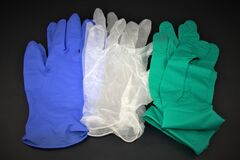 Free Pairs Of Medical Gloves On Black Background Stock Photography - 182656482