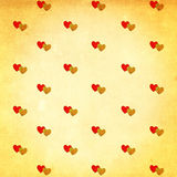 Pairs of red and gold heart on old paper Stock Photo