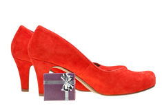 Red high heel pumps with small gift box Stock Photo