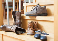 Pairs of shoes. Fall in home interior Royalty Free Stock Photography