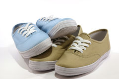 Pairs of Shoes. Beige and blue Royalty Free Stock Photography