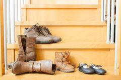 Pairs of shoes  in home Stock Images