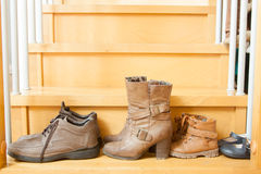 Pairs of shoes  on  stairs Royalty Free Stock Image