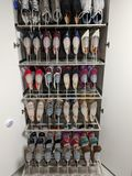 80 pairs of shoes in storage Stock Photos