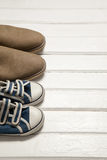 Pairs of shoes on white floor Stock Image