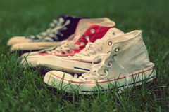 Pairs of sneakers in green grass. On the garden Royalty Free Stock Photo