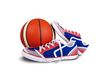 The pairs of sneakers with orange basketball Royalty Free Stock Images