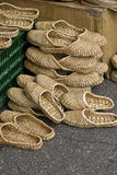 Pairs of straws slippers Royalty Free Stock Images
