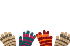 Pairs of striped gloves. Stock Photos