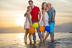 Pairs of Sweet Couples at the Sea Water Stock Photos