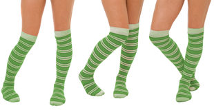 Pairs of women legs in green socks. Pairs of women legs in color green socks standing in different poses isolated on white Stock Photography