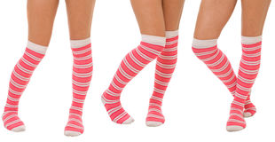 Pairs of women legs in pink socks. Pairs of women legs in color pink socks standing in different poses isolated on white Royalty Free Stock Image