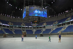 Pais Arena. Journalists wander around the new Pais Arena Arena, costing about $112 million, financed in large part by the national lottery. It is a sports and Stock Photo
