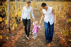 Pais com o bebê no outono Fotografia de Stock