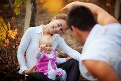 Pais com o bebê no outono Fotografia de Stock Royalty Free